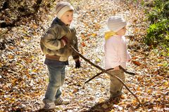 Kids in autumn forest Royalty Free Stock Photo