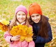 Kids at autumn Stock Photo