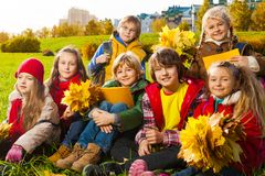 Kids on autumn lawn royalty free stock images