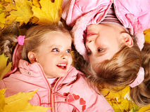 Kids in autumn orange leaves. Royalty Free Stock Photography