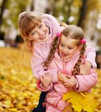 Kids in autumn orange leaves. Stock Photo