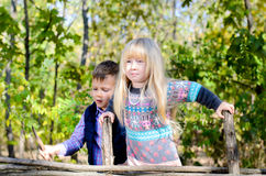 Kids in Autumn Outfit Playing at the Wooden Fence Royalty Free Stock Photos