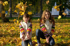 Kids in autumn park Royalty Free Stock Photo