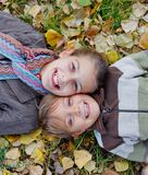 Kids in autumn park Stock Photo