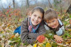 Kids in autumn park Stock Image