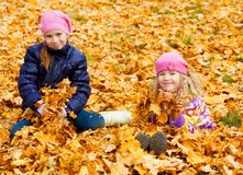 Kids at autumn park Stock Photography
