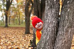 Kids in autumn park with pumpkin. Around fall leaves Stock Images