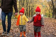 Kids in autumn park with pumpkin. Around fall leaves Stock Photography