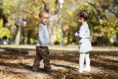 Kids in the autumn park stock photos