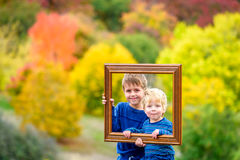 Kids in autumn park Royalty Free Stock Image