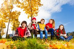 Kids and autumn in the town Royalty Free Stock Image