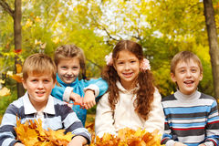 Kids in autumnal park. Portrait of four friendly kids in autumnal park stock photo