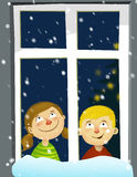 Kids awaiting chrismas. Kids sitting in a window awaiting fist star Stock Photos