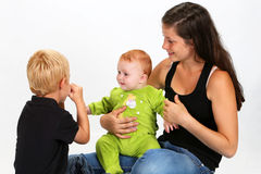 Kids and Babysitter. Babysitter playing with a baby girl and little boy stock photos