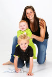 Kids and Babysitter Royalty Free Stock Photography