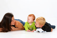 Kids and Babysitter stock images