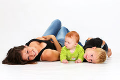 Kids and Babysitter. Babysitter playing with a baby girl and little boy Stock Photography