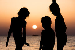 Kids on background of sea sunset and ship Stock Photography