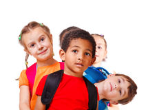 Kids with backpacks. School aged kids with backpacks, isolated stock images
