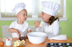 Kids bakes muffins Royalty Free Stock Image