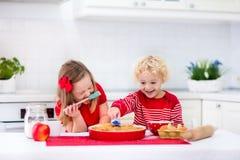 Kids baking apple pie Royalty Free Stock Image