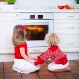 Kids baking apple pie Stock Photography
