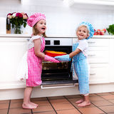 Kids baking apple pie royalty free stock images