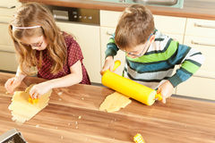 Kids are baking Stock Images