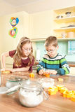 Kids are baking. Children baking cookies in the kitchen Royalty Free Stock Images