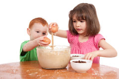 Kids baking chocolate chip cookies Royalty Free Stock Image