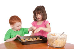 Kids baking chocolate chip cookies isolated Royalty Free Stock Photography