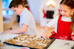 Kids baking Christmas cookies Stock Images