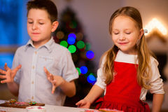 Kids baking Christmas cookies Stock Images