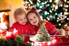 Kids baking on Christmas eve Stock Images