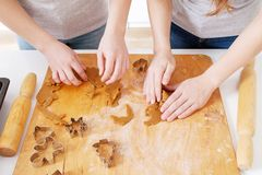 Free Kids Baking Christmas Gingerbread Cookies In House Kitchen On Winter Day. Close-up Child`s Hands Preparing Cookies Using Cookie Stock Photo - 163360760