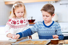 Kids baking cookies Royalty Free Stock Images