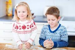 Kids baking cookies Stock Photos