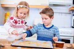 Kids baking cookies Stock Photo