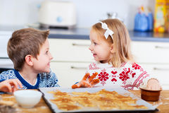 Kids baking cookies Stock Images