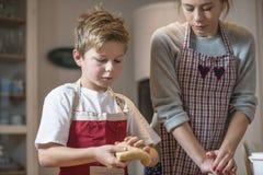 Kids baking gingerbread Stock Photos