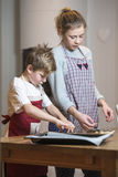Kids baking gingerbread Royalty Free Stock Photography