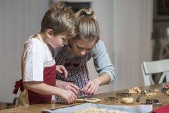 Kids baking gingerbread Royalty Free Stock Photos