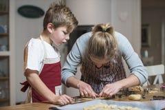 Kids baking gingerbread Stock Photo
