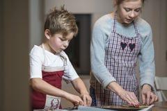 Kids baking gingerbread Royalty Free Stock Images