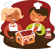 Kids baking Gingerbread house Royalty Free Stock Photo