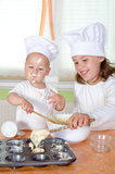 Kids baking Muffins Stock Photos