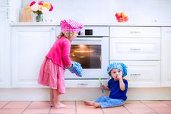 Kids baking pie Royalty Free Stock Image