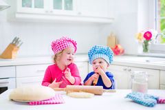 Kids baking pie Stock Photos