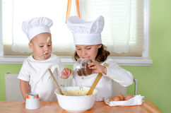 Kids are baking Royalty Free Stock Image