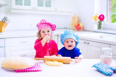 Kids baking in a white kitchen Royalty Free Stock Image